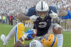Penn State's Marcus Allen looks down at Pitt's Darrin Hall after tackling him for a safety in September.