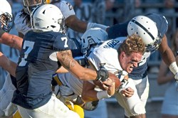 Pitt quarterback Max Browne's helmet flies off after getting sacked in the second half during the Pitt-Penn State game in September.