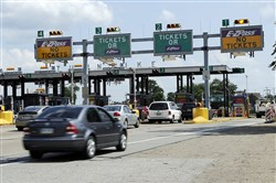 Vehicles make their way through the toll plaza for the Pennsylvania Turnpike in Monroeville.