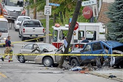 Pittsburgh police investigate at a scene involving a shooting and a multi-vehicle crash in Beltzhoover on Monday.