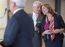 Allegheny County Airport Authority CEO Christina Cassotis laughs with VisitPittsburgh CEO Craig Davis during the Pittsburgh International Airport's growth announcement on Tuesday in Moon. In the foreground is  PA State Rep. Mark Mustio.