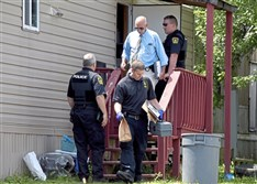 Investigators at the scene of a shooting in West Mifflin in August, in which, police said, a 10-year-old shot his 6-year-old brother in the head.