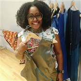 Fashion designer Tereneh Mosley of the North Side holds the confluence dress, a garment inspired by Pittsburgh's three rivers. She presented the spring collection of her Idia'Dega fashion line Monday at New York Fashion Week.