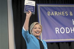 "NEW YORK, NY - SEPTEMBER 12: Former U.S. Secretary of State Hillary Clinton holds up a copy of her new book ""What Happened"" at a book signing event at Barnes and Noble bookstore, September 12, 2017 in New York City."
