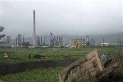 In this 2016 file photo, farmers work their fields outside the Sungri Chemical Factory, an oil refinery in the Rason Special Economic Zone near North Korea's Russian and Chinese borders.