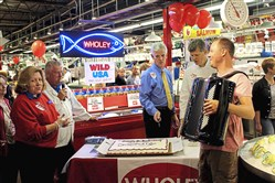 Employees prepare for cake cutting along with accordionist Kevin Solecki during a birthday celebration at Wholey's in the Strip District. Wholey's will celebrate its 105th anniversary on Saturday with a seafood class, live music, cake, petting zoo, airbrush tattoos, balloons and more.