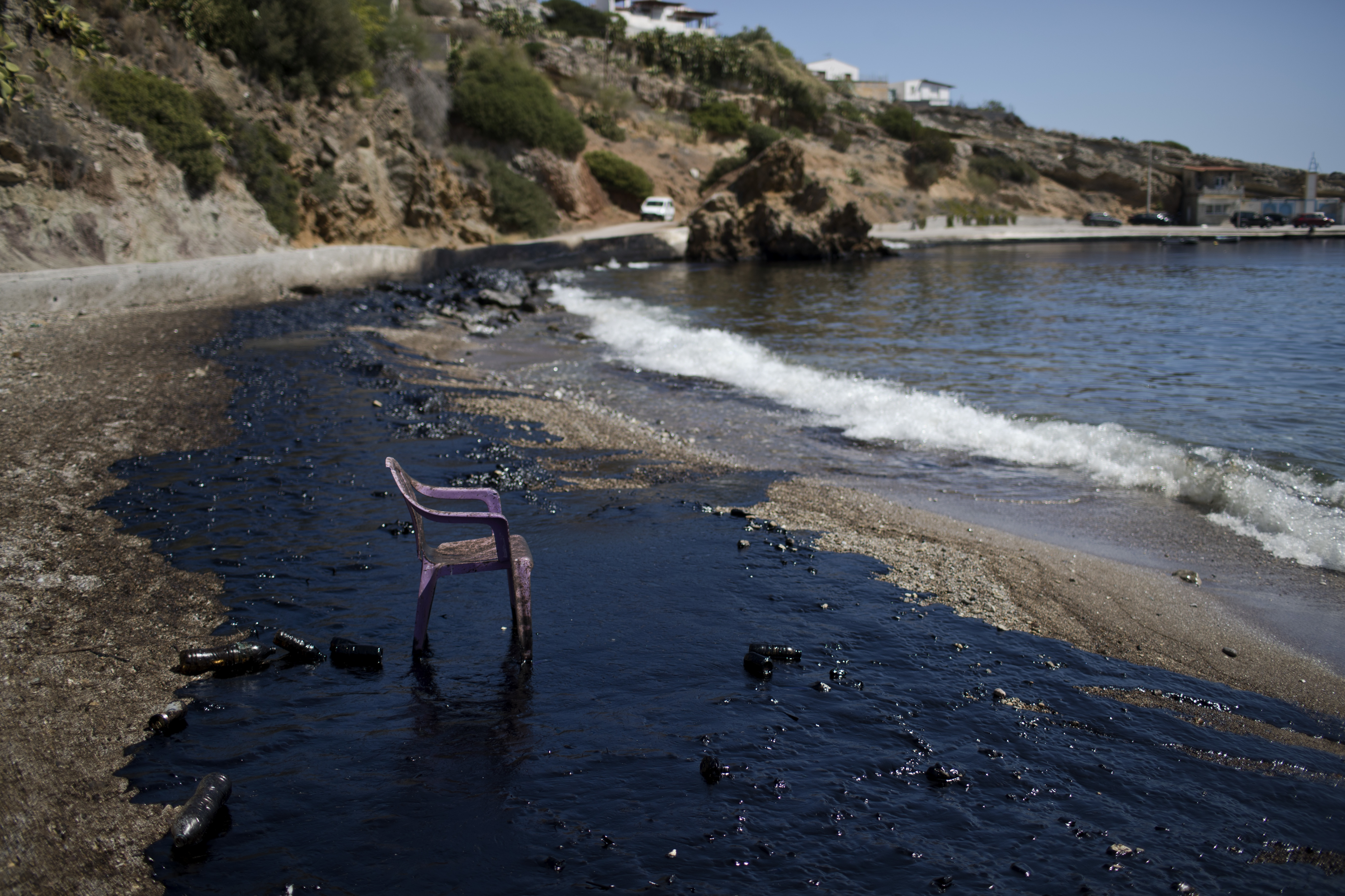 APTOPIX Greece Tanker Pollution A plastic chair stands on a polluted beach by a big oil spillage on the island of Salamina, near Athens, on Tuesday, Sept. 12, 2017. Greece's merchant marine minister says clean-up crews are working to contain pollution caused after the small tanker Agia Zoni II sank off Salamina on Sunday, Sept. 10, with a cargo of 2,200 tons of fuel oil and 370 tons of marine gas oil. (AP Photo/Petros Giannakouris)