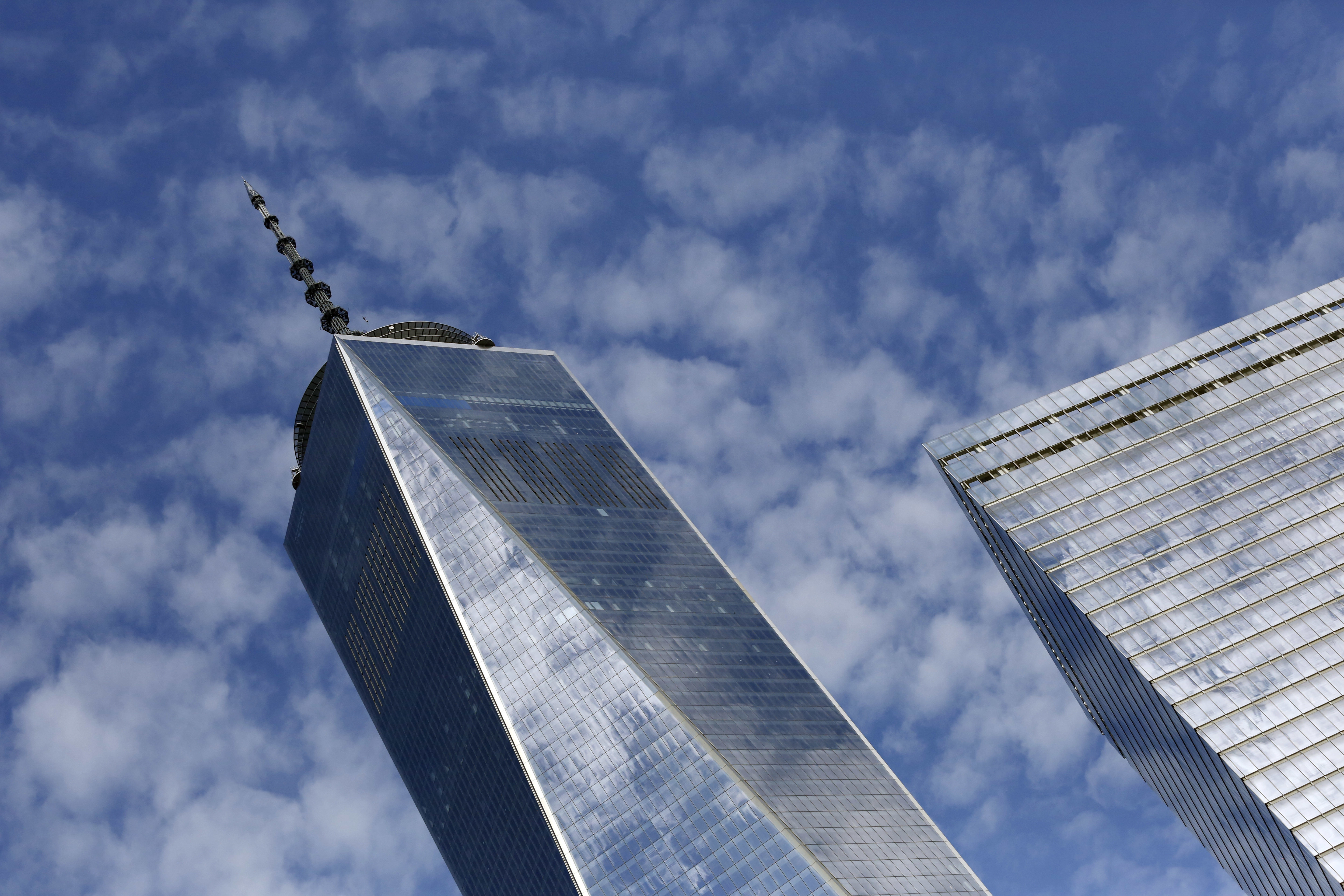 Financial Markets FILE - This Tuesday, Aug. 16, 2016, file photo shows One World Trade Center, left, and 7 World Trade Center, in New York. U.S. stocks slip away from record highs, Thursday, Sept. 14, 2017, as technology and health care companies sink, with prescription drug distributors taking some of the biggest losses. (AP Photo/Mark Lennihan, File)