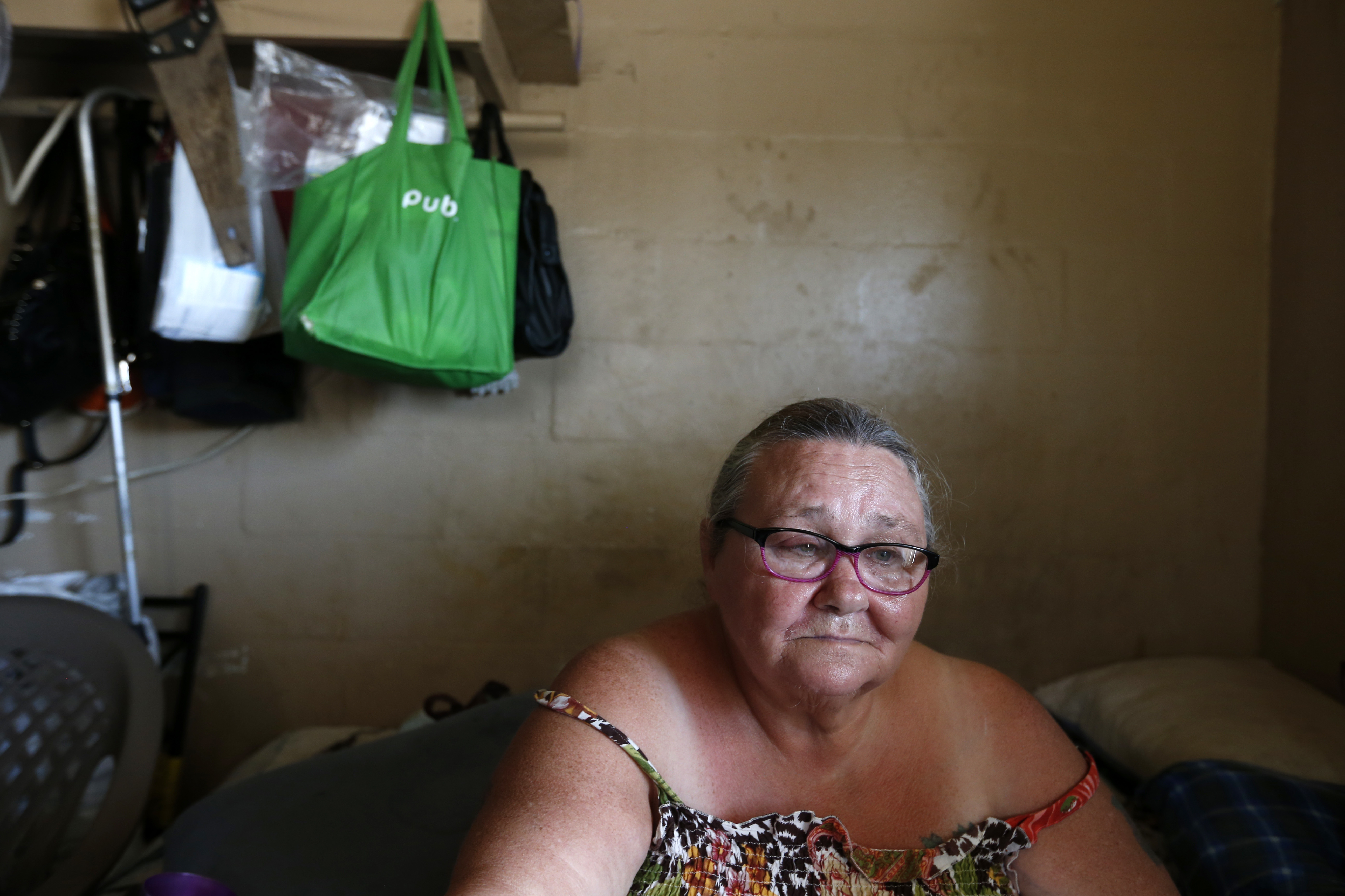 Irma The Poor-9 In this Sept. 12, 2017 photo, Pattie Deeley, who has asthma and other health problems which keep her on supplemental oxygen, sits in her small cinderblock apartment during a multi-day power failure in the aftermath of Hurricane Irma, in Immokalee, Fla. Unable to cook after the storm, Deeley said she had to spend extra money buying meals after Irma. (AP Photo/Gerald Herbert)