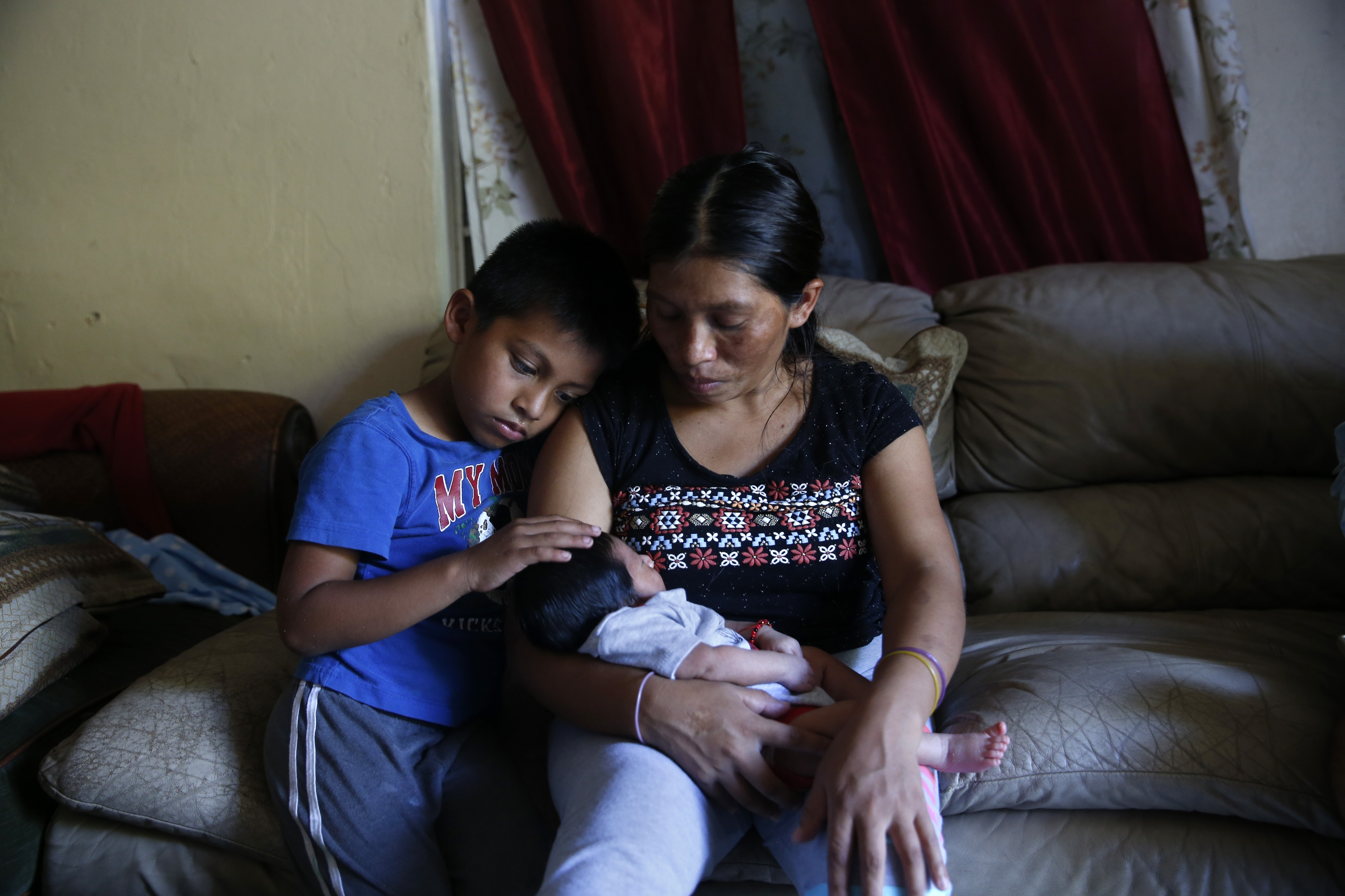 Irma The Poor In this Sept. 12, 2017 photo, Aura Gaspar sits with her two-week old baby Ashley, and her son, Isaac, 5, in their home, dark due to a power failure from Hurricane Irma, in Immokalee, Fla. Gaspar said they spent $600 getting ready for Irma, the equivalent of two weeks pay. (AP Photo/Gerald Herbert)