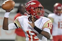 Penn Hills quarterback Hollis Mathis, throwing against Pine-Richland on Sept, 15, had a big game Saturday, throwing for five touchdowns.