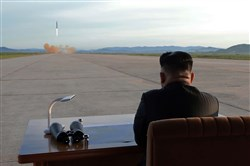 An undated picture released from North Korea's official Korean Central News Agency (KCNA) on Sept. 16 shows North Korean leader Kim Jong-Un inspecting a launching drill of the medium-and-long range strategic ballistic rocket.