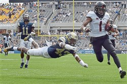 Oklahoma State's Jalen McCleskey scores a touchdown against Pitt's Jazzee Stocker in the second quarter Saturday, September 16, 2017 at Heinz Field in Pittsburgh.