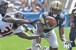 Pitt's Jester Weah can't come up with the ball as he's defended by Oklahoma State's Tre Flowers Saturday.