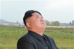 In this undated photo distributed Saturday by the North Korean government, North Korean leader Kim Jong Un watches what was said to be the test launch of an intermediate range Hwasong-12 missile at an undisclosed location in North Korea.