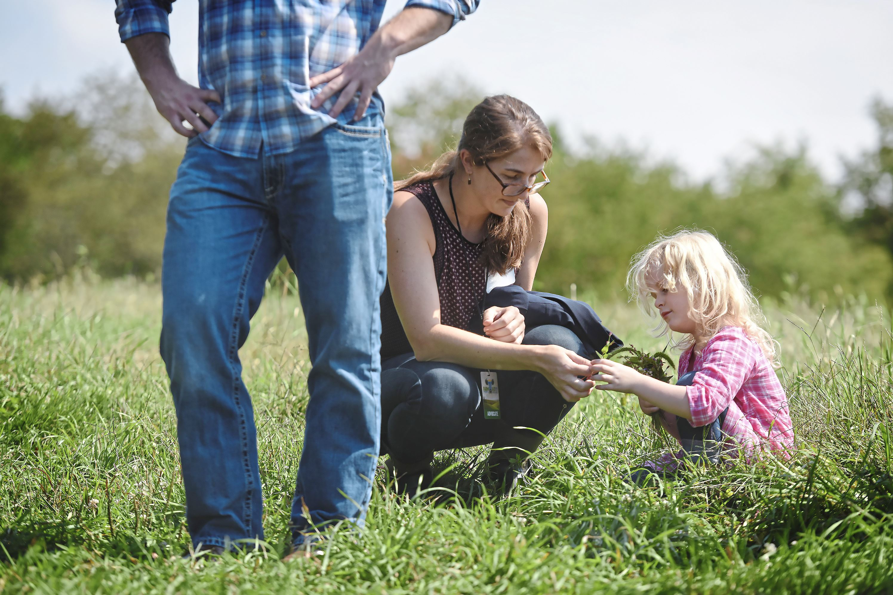 20170915smFarmAid001 Teryn Adkins, 5, shows a plant to Sarah Buranskas during a tour Friday of Kretschmann Organic Farm near Zelienople.