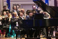 World-renowned pianist Lang Lang, left, and 14-year-old prodigy Maxim Lando perform during the Pittsburgh Symphony Orchestra's gala on Saturday night in Heinz Hall, Downtown.