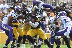 Le'Veon Bell carries Sunday in the Steelers' home opener against Minnesota.