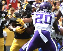 Steelers receiver JuJu Smith-Schuster scores a touchdown in the second quarter against the Minnesota Vikings Sunday at Heinz Field.