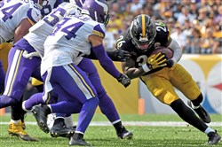 Le'Veon Bell carries against the Vikings.