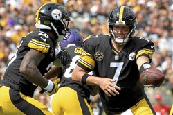 Le'Veon Bell takes a handoff from quarterback Ben Roethlisberger in the first quarter. Bell was more active this Sunday, rushing for 87 yards on 27 carries in the victory against the Minnesota Vikings.