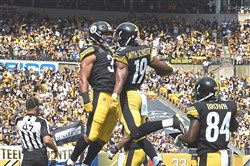 JuJu Smith-Schuster celebrates after scoring his first touchdown as an NFL player.