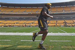 Stephon Tuitt goes through drills before warmups Sunday, September 17, 2017, at Heinz Field.