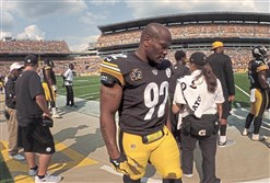 James Harrison paces the sideline during the second half of Sunday's game.
