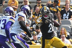Le'Veon Bell rushes Sunday against the Vikings.
