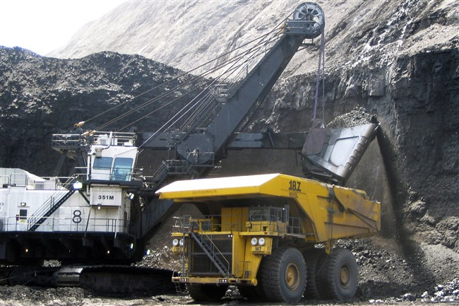 In this 2007 file photo, a shovel prepares to dump a load of coal into a 320-ton truck at the Arch Coal Inc.-owned Black Thunder mine in Wright, Wyo.