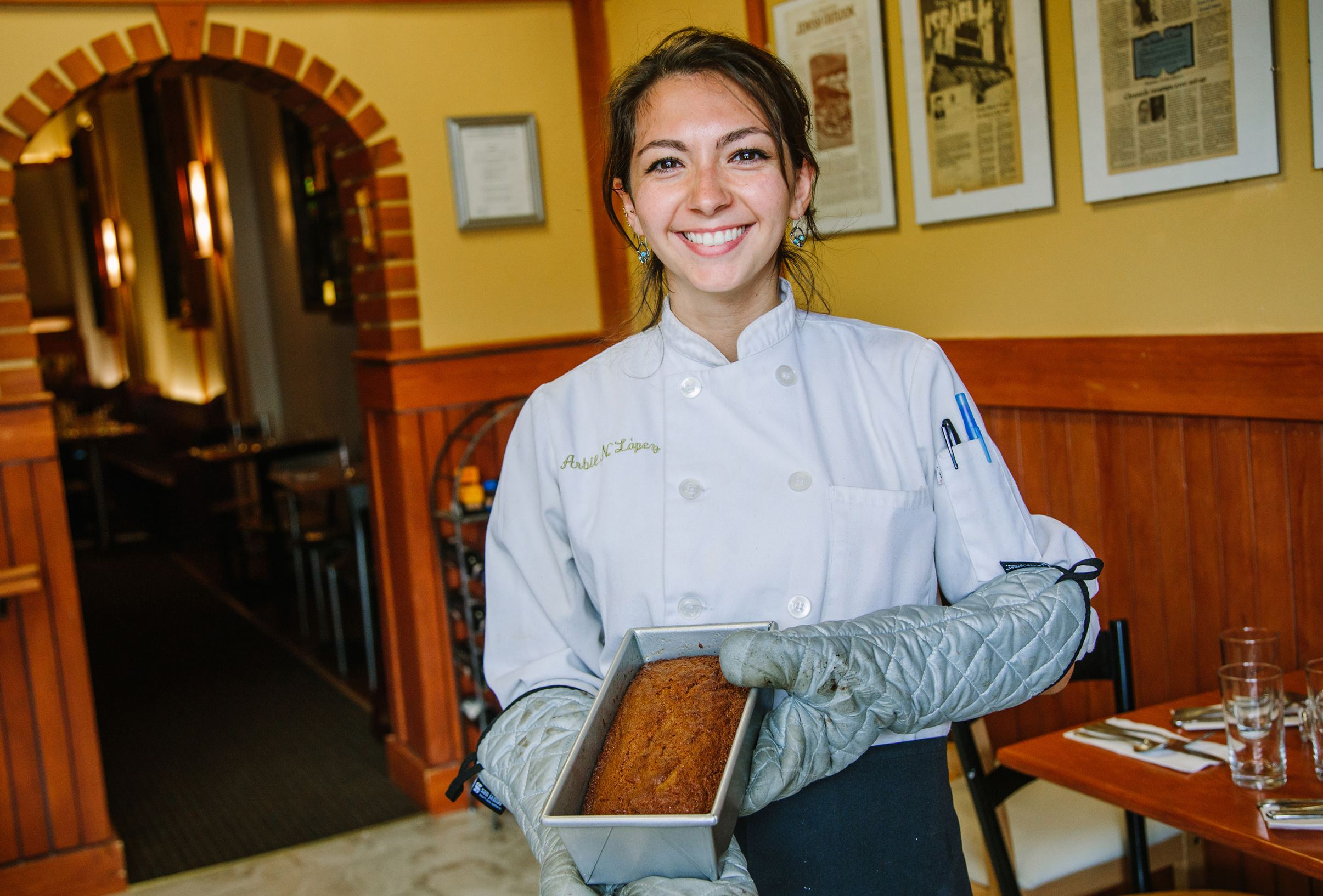 HoneyCake0917 Pastry chef Arbil Lopez poses for a photo with a honey cake at Cafe Eighteen in Squirrel Hill.
