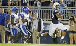 Penn State's Saquon Barkley pulls away from the Georgia State defense for a touchdown Sept. 16 at Beaver Stadium.