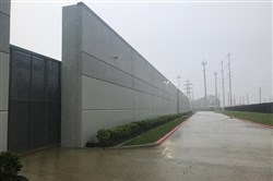 An undated handout photo shows rain from Hurricane Harvey in August 2017 pummeling the Skybox data center — which was prepared for the storm with backup generators, bunks and showers  — west of Houston.