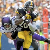 Steelers running back Le'Veon Bell runs through a tackle by Vikings safety Harrison Smith in the first quarter of a game last September at Heinz Field. (Matt Freed/Post-Gazette)