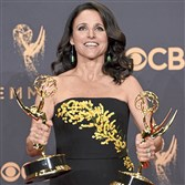 "Julia Louis-Dreyfus poses in the press room with her awards for outstanding lead actress in a comedy series and outstanding comedy series for ""Veep"" at the 69th Primetime Emmy Awards on Sunday, Sept. 17, 2017, at the Microsoft Theater in Los Angeles."