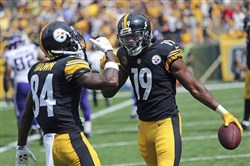 Receiver JuJu Smith-Schuster scored his first career touchdown Sunday against the Minnesota Vikings.
