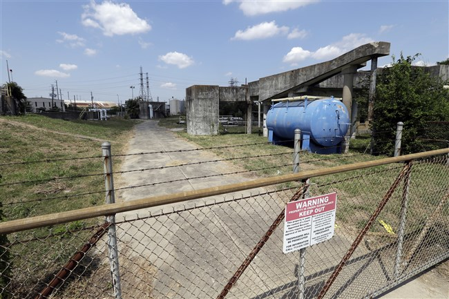A gate at the U.S. Oil Recovery Superfund site is shown Sept. 14 in Pasadena, Texas, where three tanks once used to store toxic waste were flooded during Hurricane Harvey.