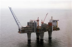 "FILE - In this photo dated June 8 2006, The Troll, a gas platform run by the Norwegian oil giant Statoil company, standing above the North Sea, about 70 kilometers off the coast of Norway. Norway's sovereign wealth fund, the world's largest of its kind, has hit ""a milestone"" $1 trillion in value for the first time, beating all expectations since its creation over 20 years ago, on Tuesday, Sept. 19, 2017. (Marit Hommedal / Scanpix via AP, File)"