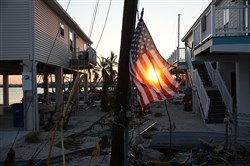 An American flag is seen attached to an electric pole as people begin the process of rebuilding after Hurricane Irma passed through the area Sept. 18 in Marathon, Fla.