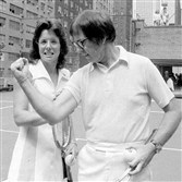 "Billie Jean King and Bobby Riggs in a promotional photo for their September 1973 tennis match, touted as ""the battle of the sexes."""