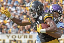 Rookie JuJu Smith-Schuster tries to break away from Minnesota Vikings defender Trae Waynes in the fourth quarter of the Steelers' victory Sunday at Heinz Field.