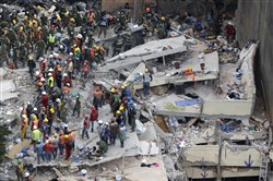 Rescue workers search for people trapped inside a collapsed building in the Del Valle area of Mexico City on Sept. 20.