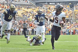 Oklahoma State's Justice Hill runs into the end zone for a touchdown against Pitt in the second quarter Saturday.