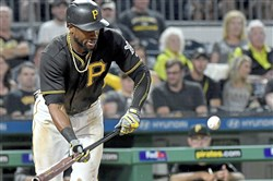 Pirates Starling Marte bunts against the Brewers in the sixth inning Sept. 19 at PNC Park in Pittsburgh.