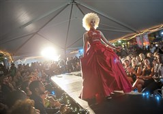 "Model Sindel Taylor of Carnegie wears a dress by Clairton-based designer Malcolm Williams' line Willie Gee's in Fashion Week Downtown's ""The Runway"" show on Tuesday, Sept. 19, 2017, in Market Square."