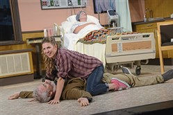 "Tim McGeever, Jenni Putney and Kendra McLaughlin (in bed) rehearse the comedy by playwright Halley Feiffer, ""A Funny Thing Happened on the Way to the Gynecologic Oncology Unit at Memorial Sloan-Kettering Cancer Center of New York City."""