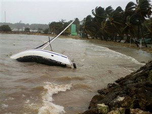 A boat lies on its side off the shore of Sainte-Anne on the French Caribbean island of Guadeloupe, early Tuesday after the passing of Hurricane Maria.