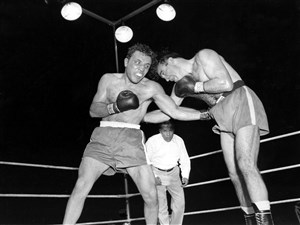 In this June 16, 1949, file photo, Jake LaMotta, left, pounds Marcel Cerdan in third round of a world middleweight title bout in Detroit, Mich. LaMotta won the title by a knockout in the 10th round.