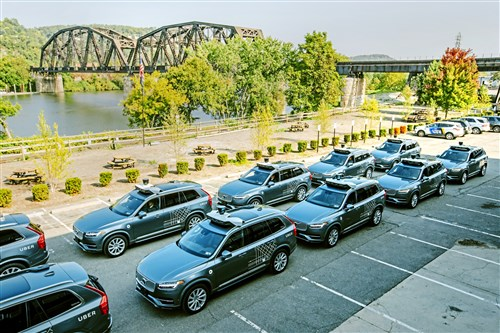 A fleet of the first iteration of the Volvo XC90 self-driving Uber vehicles parked outside of the Uber Advanced Technologies Group building during a press event on Wednesday, September 20, 2017 in the Strip District. (Andrew Rush/Post-Gazette)