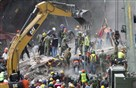 Rescue personnel work on a collapsed building, a day after a devastating 7.1-magnitude earthquake, in the Del Valle neighborhood of Mexico City, Wednesday. Efforts continue at the scenes of dozens of collapsed buildings, where firefighters, police, soldiers and civilians continue their search to reach the living.